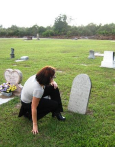 Paranormal Researcher Erin Broemel Reads a Headstone