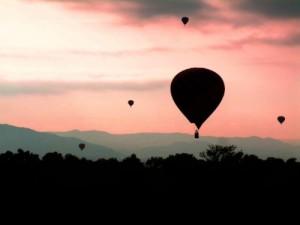 Balloons dot the sky over the Sandia Mountains at sunrise in Albuquerque, New Mexico during the Albuquerque International Balloon Fiesta. Enter to win a trip to the world's largest balloon festival at www.ItsATrip.org/balloon-festival. Photo credit: www.morimotophotography.com. (PRNewsFoto/Albuquerque Convention & Visitors Bureau)