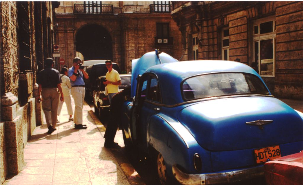 American Visitors Admire an American Car in Havana, Cuba, Dec. 2003
