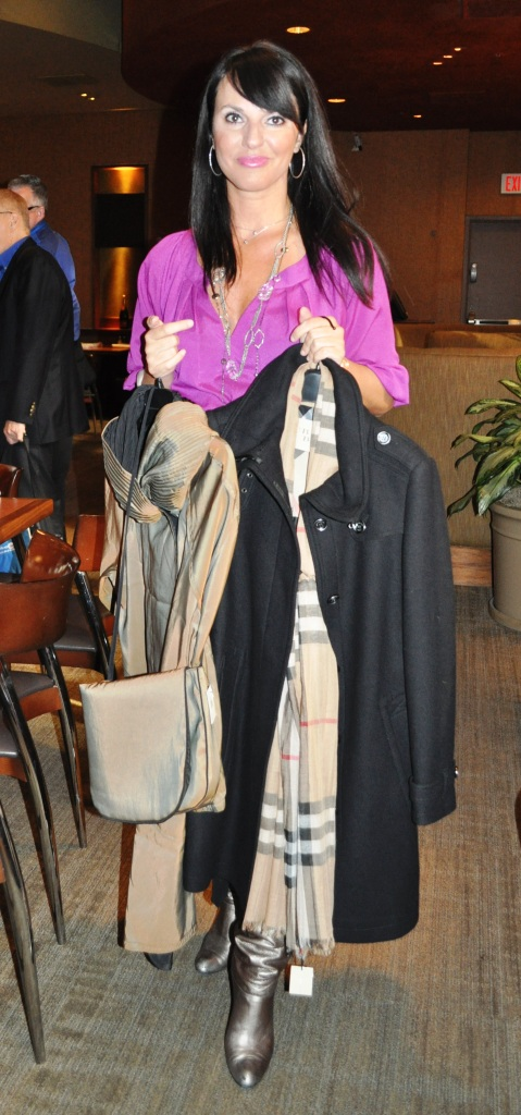 Nordstrom Personal Stylist Maria Holds the Mycra Pac Designer Wear Reversible Scrunch Neck Travel Coat (L) and a Burberry Brit (R)