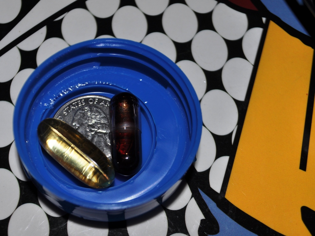 Fish Oil Capsule to the Left, Viva Labs to the Right with a Quarter in the Middle