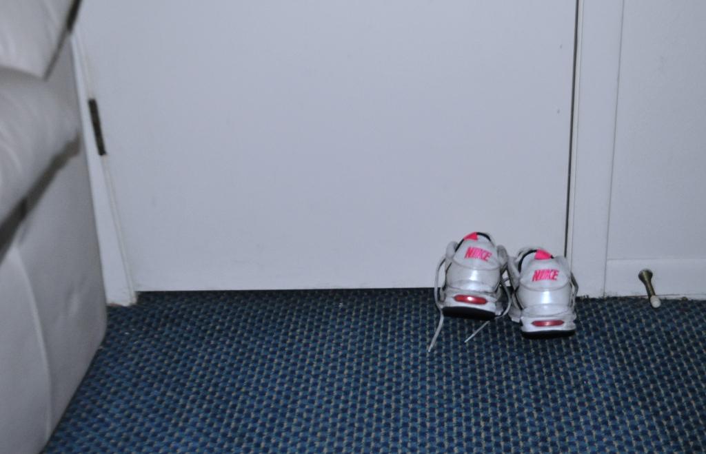 Sneakers Make Portable Hotel Room Doorstops