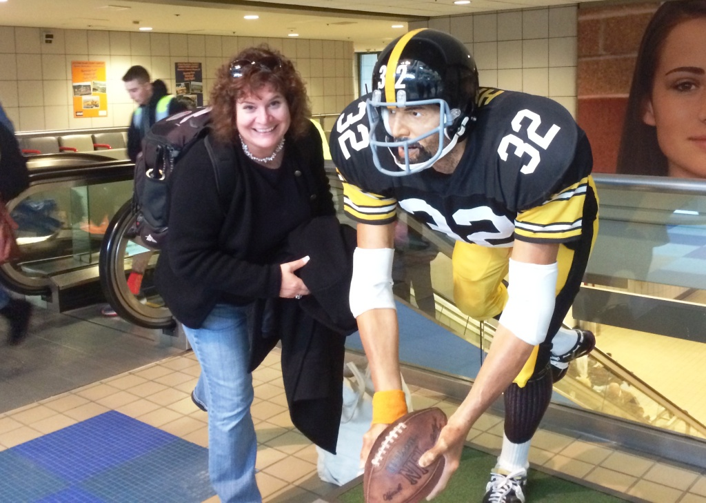 "That's me! At the Pittsburgh International Airport with the statue commemorating the 1972 ""Immaculate Reception."""