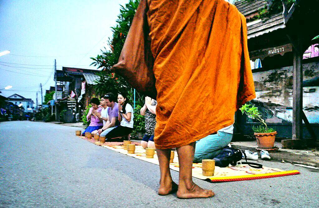 A monk chants a prayer after receiving his alms in Chiang Khan in the Loei Province of Thailand, March 2015