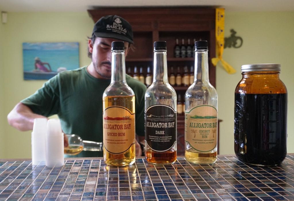 Alexander Voss, Distiller at Alligator Bay Distillers, Pours Rum During in the Tasting Room.