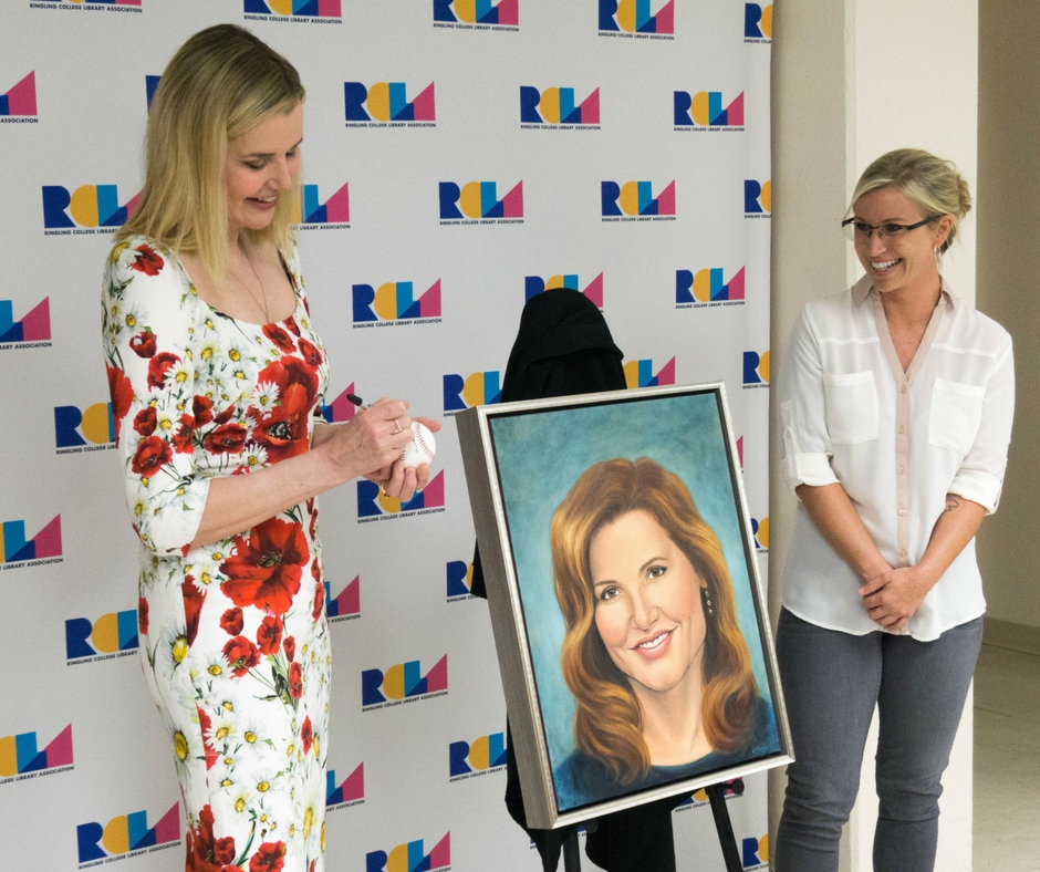 Advocate and Actor Geena Davis Signs a Baseball for Ringling College Student Artist Elizabeth Gray. Gray Created the Portrait of the Artist Which Was Presented to Her Prior to Davis's Feb. 13, 2013 Lecture in Sarasota, Fla.