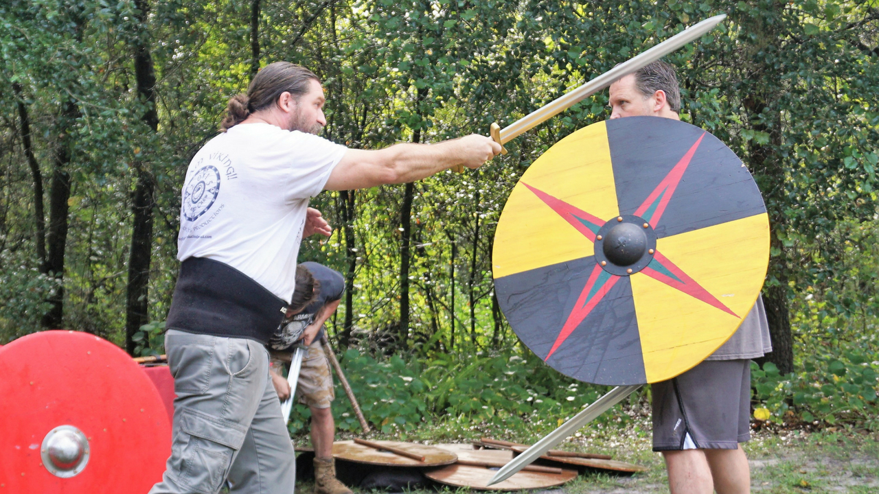 Brent Feagans of Wyrd Brothers Productions Demonstrates One of the Proper Ways to Safely Weild a Sword During Viking Fitness Training