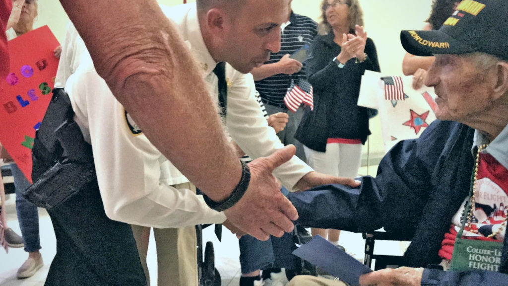 Lee County Sheriff Carmine Marceno Thanks a Veteran During the Honor Flight Welcome Home Ceremony May 4, 2019, at Southwest Florida International Airport in Ft. Myers, Fla.