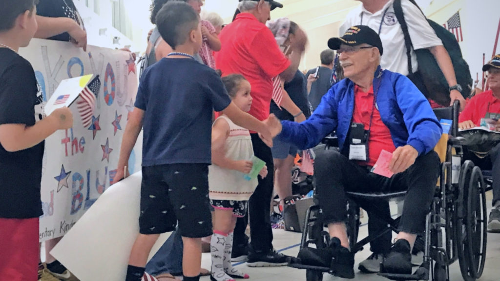A Student Thanks a Veteran During the Honor Flight Welcome Home Ceremony May 4, 2019, at Southwest Florida International Airport in Ft. Myers, Fla.