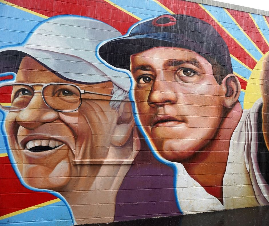 """Left Hander for Life"" Mural Shows Legendary Hamilton Native Joe Nuxhall as a Young Cincinnati Reds Pitcher and Later in Life. Painted in 2017 by Paul Loehle as the Lead Artist"