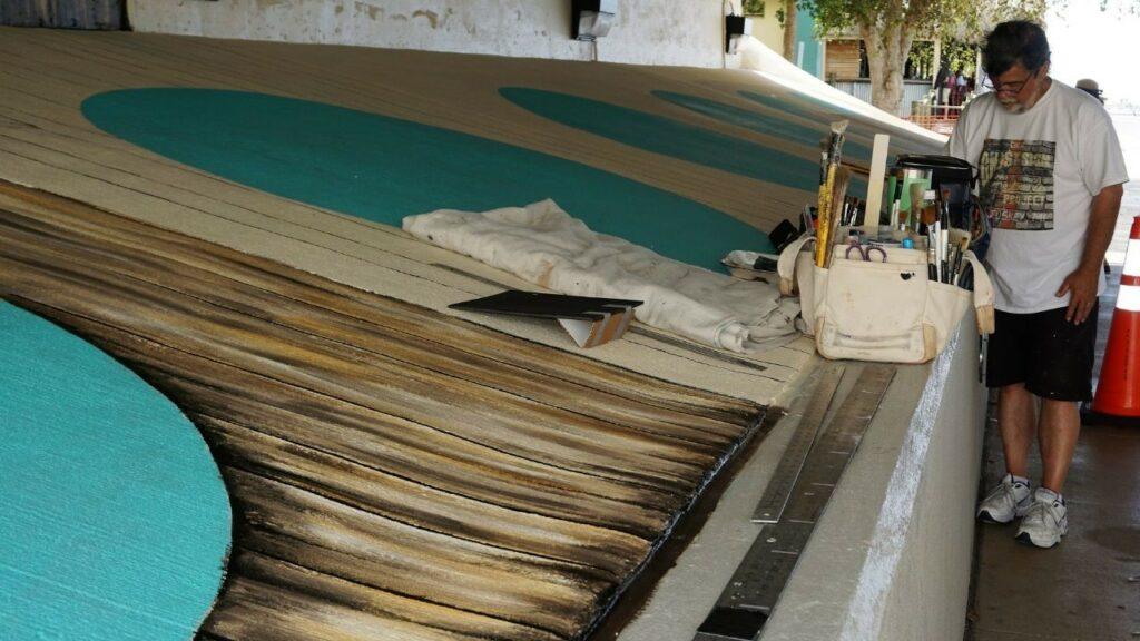 "Florida Mural Artist Skip Dyrda Working on ""Tails from the Harbor"" in Punta Gorda, Fla."