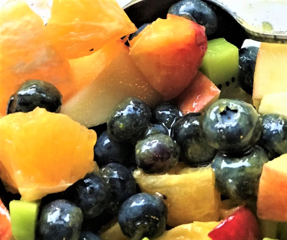 Fresh Blueberries Mixed with Fresh Fruit and Topped with Honey and Lime Zest. Yum!